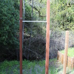 Installed his and hers pull-up bars in workout fanatic's backyard