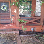 Removed rotten porch boards and rebuilt and painted portion of porch to match original.