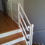 """Installed durable 3/16"""" plastic to retain open look of wrought iron staircase while making sure railing is safe for a toddler."""