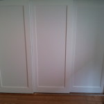 Installed 3 panel doors on custom sliding track for extra wide closet.