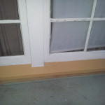 """Removed previous """"quick fix"""" of fiberglass capping to hide rotten window sill and cut down custom piece of redwood to match the pitch of the original sill.  Caulked, patched, primed and painted to make it look good as new."""
