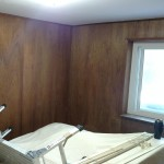 Before & After: client is preparing to put property on the market so we assisted in selecting a neutral paint color and updated the wood paneling to give the guest room an inexpensive and quick transformation.