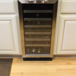 Removed trash compactor and installed under counter wine fridge.