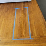 Removed floor outlet and sanded and refinished to match original hardwood floors.